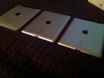 Three iPads side-by-side.